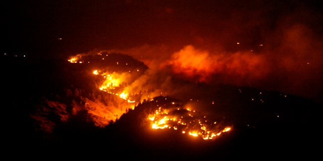 March 21, 2011: In this photo the Indian Gulch fire burns west of Golden, Colo.