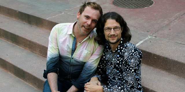 June 6, 2013: Dave Mullins, right, sits for a portrait with his husband Charlie Craig, in Denver.