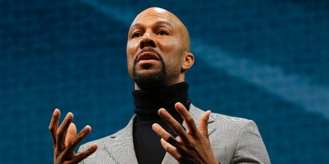 FILE - In this Wednesday, March 18, 2015, file photo, singer and actor Lonnie Rashid Lynn, better known by his stage name Common, speaks at Starbucks Coffee Company's annual shareholders meeting in Seattle. New Jersey's Kean University has canceled hip-hop artist Common as commencement speaker after police voiced concerns over a song about a convicted cop killer who fled to Cuba. (AP Photo/Ted S. Warren, File)