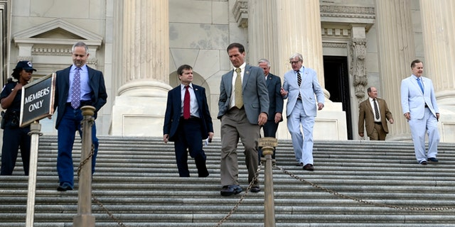 FILE: July 29, 2015: House members walk down the steps on Capitol Hill in Washington, D.C.