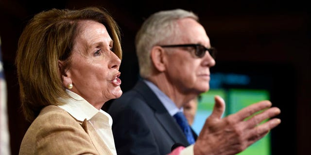 FILE: June 25, 2015: House Minority Leader Nancy Pelosi of Calif., and Senate Minority Leader Harry Reid, of Nev., on Capitol Hill, Wash., D.C.
