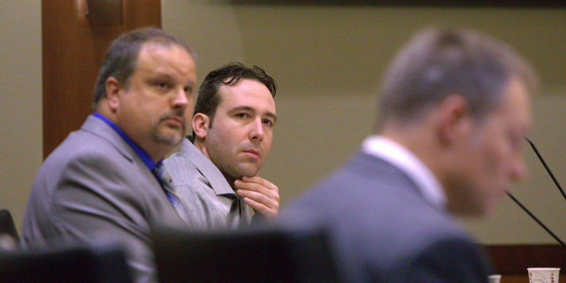 William Hoehn, center, listens to the charges read against him on Wednesday, Sept. 19, 2018, in Fargo, N.D., for the murder of Savanna LaFontaine-Greywind, a 22-year-old whoss baby was cut from her womb. Hoehn is charged with conspiracy to commit murder in the death of 22-year-old Savanna Greywind, who was eight months pregnant when she was killed in August 2017. (Michael Vosburg/The Forum via AP, Pool)