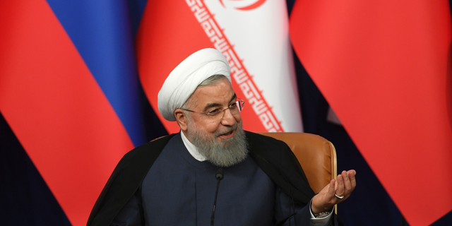 Iran's President Hassan Rouhani attends a news conference following the Russia-Iran-Turkey summit in Iran on Friday, Sept. 7, 2018. (Kirill Kudryavtsev/Pool Photo via AP)