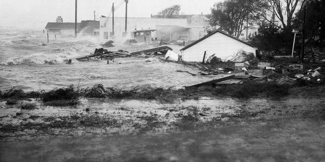 FILE-In this Oct. 15, 1954 file photo, High tides, whipped in by Hurricane Hazel, shatter boats and buildings in Swansboro, N.C., as the storm lashes the Atlantic seaboard. The last time the midsection of the East Coast stared down a hurricane like Florence, Dwight Eisenhower was in the White House and Marilyn Monroe and Joe DiMaggio were newlyweds. Florence could inflict the hardest hurricane punch the Carolinas have seen in more than 60 years, with rain and wind of more than 130 mph (209 kph). (AP Photo, File)