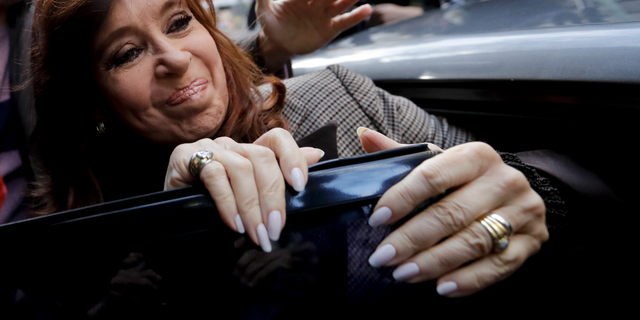 FILE - In this Aug. 13, 2018 file photo, Argentina's former President Cristina Fernandez gets into a car to go to a court hearing in Buenos Aires, Argentina. A federal judge has indicted on Monday, Setp. 17, former President Cristina Fernandez for corruption and asked for her arrest for allegedly being the head of an illegal association that collected bribes in exchange for public work contracts. (AP Photo/Natacha Pisarenko, File)