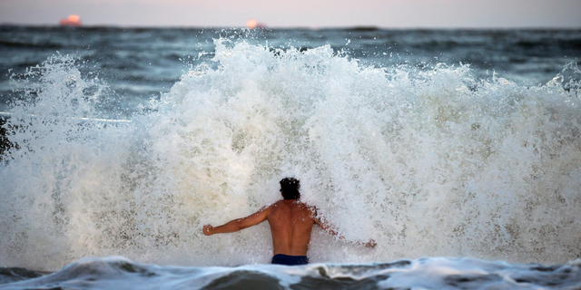 Body surfer Andrew Vanotteren, of Savannah, Ga., crashes into waves from Hurricane Florence, Wednesday, Sept., 12, 2018, on the south beach of Tybee Island, Ga. Vanotteren and his friend Bailey Gaddis said the waves have gotten bigger and better every evening as the storm approaches. (AP Photo/Stephen B. Morton, File)