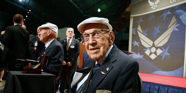 """Lt. Col. Richard """"Dick"""" Cole, seated front, was presented a Congressional Gold Medal honoring the Doolittle Raiders in April 2015."""