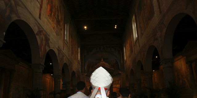 FILE - In this April 14, 2005 file photo, Washington Cardinal Theodore McCarrick enters the St. Nereus and Achilleus Church in Rome. In July 2018, Pope Francis removed the U.S. church leader as a cardinal after church investigators said an allegation that he groped a teenage altar boy in the 1970s was credible. Subsequently, several former seminarians and priests reported that they too had been abused or harassed by McCarrick as adults. (AP Photo/ Alessandra Tarantino)
