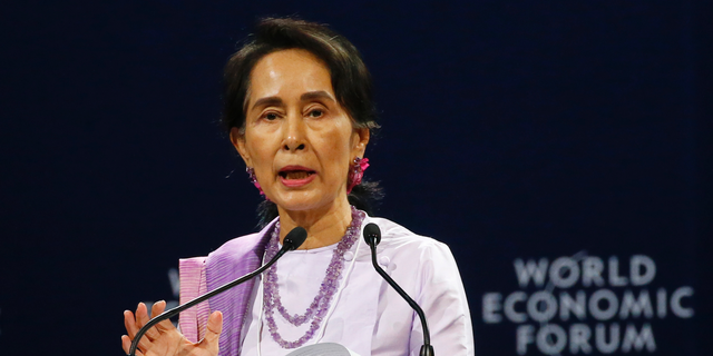 Myanmar leader Aung San Suu Kyi addresses participants during the opening session of the World Economic Forum on ASEAN Wednesday, Sept. 12, 2018 in Hanoi, Vietnam. The World Economic Forum has attracted hundreds of participants for the three-day forum with the theme: ASEAN 4.0: Entrepreneurship and the Fourth Industrial Revolution. (AP Photo/Bullit Marquez)
