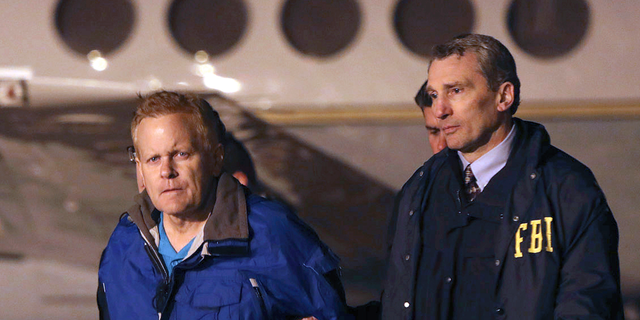 FILE - In this Dec. 5, 2017, file photo, fugitive lawyer Eric Conn, left, is taken into custody by FBI agents on the tarmac at Blue Grass Airport in Lexington, Ky. Conn, an eastern Kentucky disability attorney who masterminded the largest Social Security fraud in history, has been sentenced to an additional 15 years in prison for fleeing the country in an effort to avoid prosecution on Friday, Sept. 7, 2018. (AP Photo/Matt Goins, File)