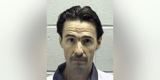 FILE - In this undated file photo released by the Georgia Department of Corrections, J.W. Ledford Jr., poses for a photo.  Lawyers for Ledford, a Georgia death row inmate argue the state's lethal injection drug will cause him unconstitutional suffering and that execution by firing squad is the only appropriate alternative. J.W. Ledford Jr. is set to be put to death Tuesday, May 16, 2017,  by injection of the barbiturate pentobarbital.  (Georgia Department of Corrections via AP)