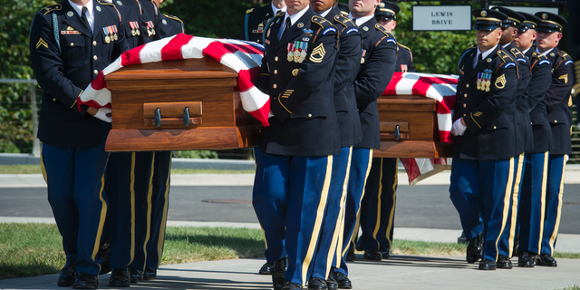 The 3rd Infantry Regiment, also known as the Old Guard, casket teams carry the remains of two unknown Civil War Union soldiers to their grave at Arlington National Cemetery in Arlington, Va., Thursday, Sept. 6, 2018. The soldiers were discovered at Manassas National Battlefield and will be buried in Section 81. Arlington National Cemetery opened the new section of gravesites with the burial.  (AP Photo/Cliff Owen)