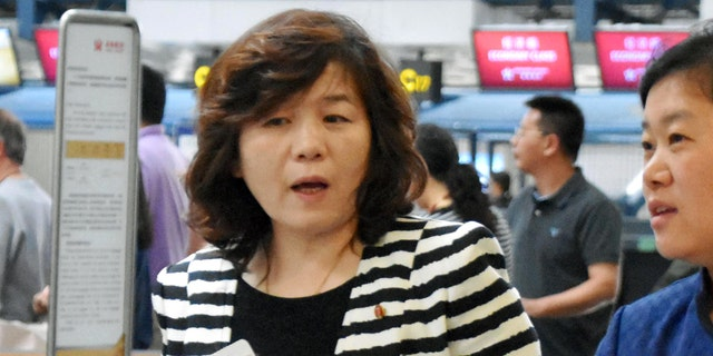 """Choi Sun-hee, left, the top North Korean diplomat who handles relations with the U.S. walks prior to her departure for Pyongyang, North Korea, at Beijing Capital International Airport in Beijing Saturday, May 13, 2017. Choi said Pyongyang would be willing to meet with the Trump administration for negotiations """"if the conditions are set,"""" briefly to reporters en route to Pyongyang. She was traveling from Norway, where she led a delegation that held an informal meeting with U.S. experts. (Kyodo News via AP)"""