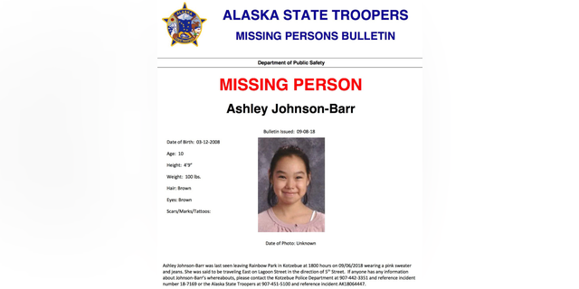 This missing person poster released by Alaska State Troopers shows Ashley Johnson-Barr, who was last seen leaving Rainbow Park in Kotzebue, Alaska, on Sept. 6, 2018, wearing a pink sweater and jeans. A search that includes multiple FBI agents has yielded no sign of Johnson-Barr, who went missing in a remote, largely Inupiat Eskimo town north of the Arctic Circle on Alaska's western coast. Now authorities are investigating whether foul play was involved.  (Alaska State Troopers via AP)
