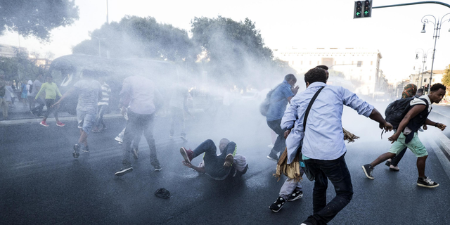 August 24, 2017: At least 13 were injured when police in Rome used water cannons to clear migrants out of a piazza.