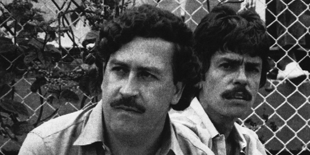 In this 1983 file photo, Medellin drug cartel boss Pablo Escobar watches a soccer game in Medellin, Colombia. (AP Photo, File)