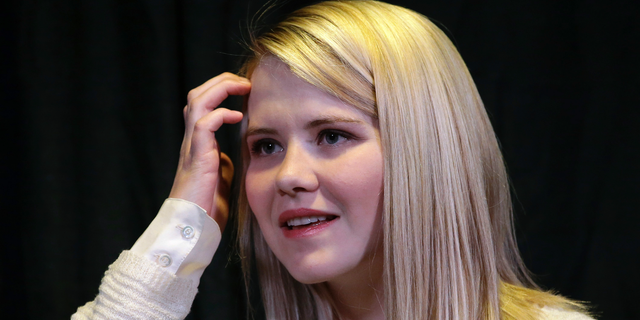 "FILE - In this April 24, 2015, file photo, kidnapping survivor Elizabeth Smart looks on during a news conference in Sandy, Utah. Wanda Barzee, a woman convicted of helping a former street preacher kidnap Smart in 2002 will be freed from prison more than five years earlier than expected, a surprise decision that Smart called ""incomprehensible"" on Tuesday, Sept. 11, 2018. (AP Photo/Rick Bowmer, File)"