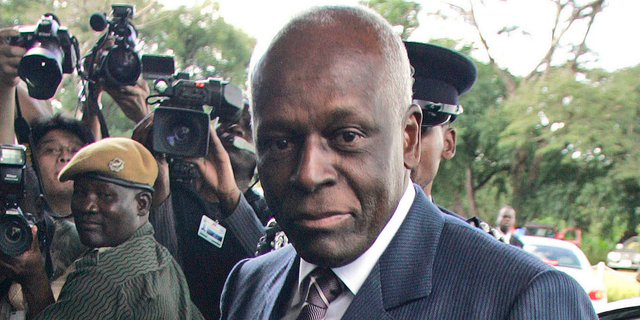 "FILE - In this April 12, 2008 file photo, the then Angola President Jose Eduardo dos Santos arrives at the Mulungushi International Conference Center in Lusaka, Zambia. Dos Santos says he made mistakes during his long rule but holds his ""head high"" as he steps down as leader of the ruling MPLA party. (AP Photo/Themba Hadebe, File)"