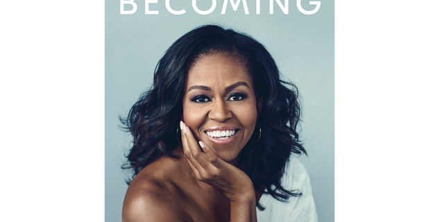 "This cover image released by Crown shows ""Becoming,"" by Michelle Obama, available on Nov. 13. Obama is launching a book tour to promote her memoir ""Becoming,"" a tour featuring arenas and other performing centers to accommodate crowds likely far too big for any bookstore. (Crown via AP)"