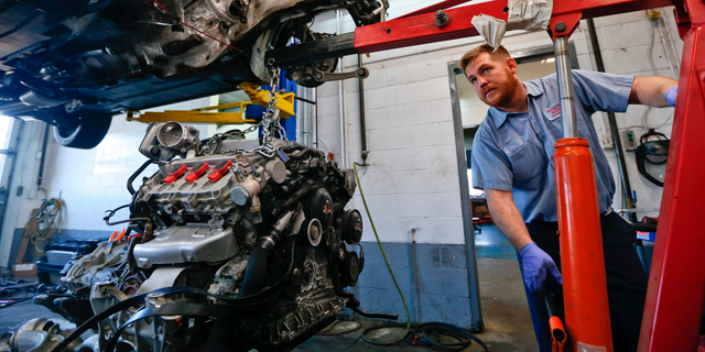 In this April 26, 2018, photo automotive technician Don Dimond prepares to separate an engine and transmission assembly at a repair shop in Harmony, Pa. On Thursday, Sept. 6, the Institute for Supply Management, a trade group of purchasing managers, issues its index of non-manufacturing activity for August. (AP Photo/Keith Srakocic)