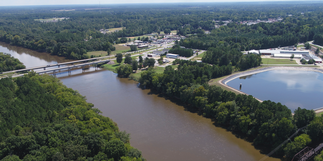 FILE - In this Tuesday afternoon, Sept. 12, 2018 file photo provided by DroneBase, an aerial view of the Cape Fear River, N.C., in Buckhorn, N.C. is shown ahead of Hurricane Florence. Record flooding is expected on North Carolina's Cape Fear River in the coming week, and signs of the coming flood are already apparent. The Cape Fear River is predicted to crest at 62 feet (nearly 19 meters) in Fayetteville on Tuesday, Sept. 18. (DroneBase via AP, File)
