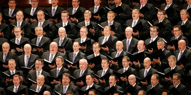 The Mormon Tabernacle Choir performs during the morning session of the two-day Mormon church conference