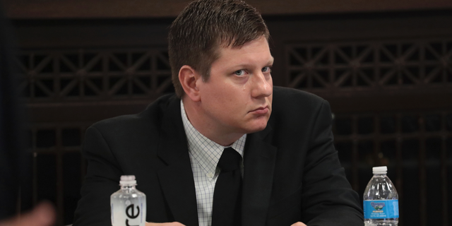 Chicago Police Officer Jason Van Dyke listens during his trial for the shooting death of Laquan McDonald at the Leighton Criminal Court Building, Monday, Sept. 17, 2018 in Chicago. McDonald died during a confrontation with Van Dyke on Oct. 20, 2014, in Chicago. (Antonio Perez/ Chicago Tribune via AP, Pool)
