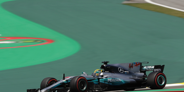 Mercedes Formula One racer Lewis Hamilton says members of his team were robbed at gun point in Brazil.