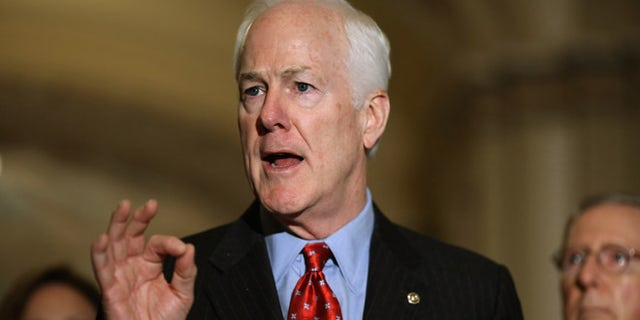 WASHINGTON, DC - OCTOBER 06:  Senate Majority Whip John Cornyn (R-TX) (L) talks to reporters after the weekly Republican policy luncheon at the U.S. Capitol October 6, 2015 in Washington, DC. Senate Republicans and Democrats are engaged in budget negotiations in an attempt to avert a possible federal government shutdown on December 11.  (Photo by Chip Somodevilla/Getty Images)