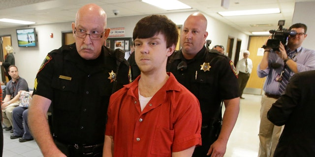 "Ethan Couch is led to a juvenile court for a hearing Friday, Feb. 19, 2016, in Fort Worth, Texas. Couch, who used an ""affluenza"" defense in a fatal drunken-driving wreck is set to appear over whether his case should be transferred to the adult system. (AP Photo/LM Otero)"