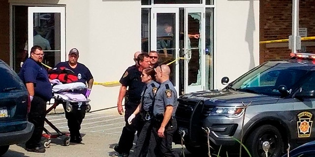 An unidentified gunman was killed by a police officer Wednesday after opening fire at a Pennsylvania magistrate's office and injuring several people, officials said.