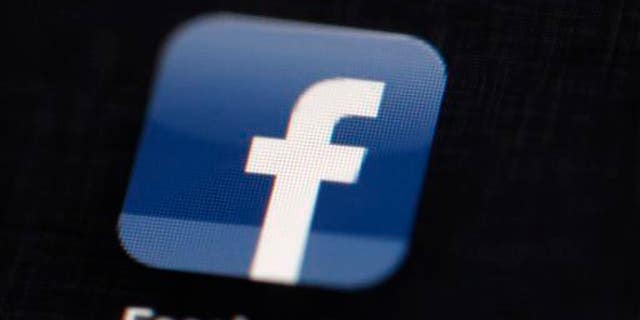 This May 16, 2012 file photo shows the Facebook logo displayed on an iPad.