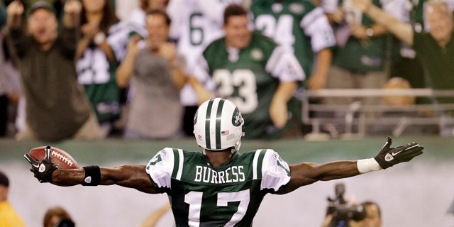 Sept. 11, 2011: New York Jets wide receiver Plaxico Burress celebrates after catching a 26-yard touchdown pass during the second half of an NFL football game against the Dallas Cowboys.
