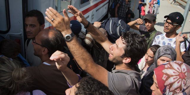 Sept. 18, 2015 -Migrants board a train in Beli Manastir, near the Hungarian border, northeast Croatia.