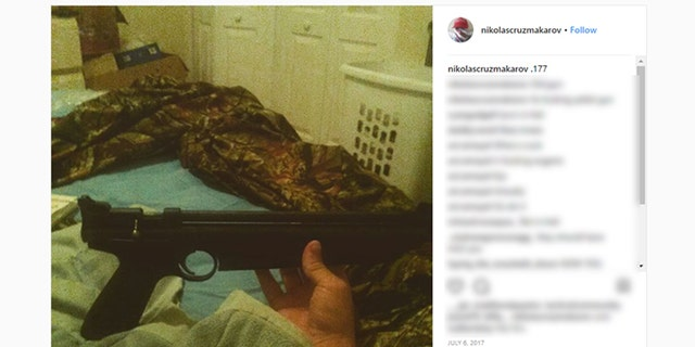 A picture on Nikolas Cruz's Instagram page shows him holding a rifle.
