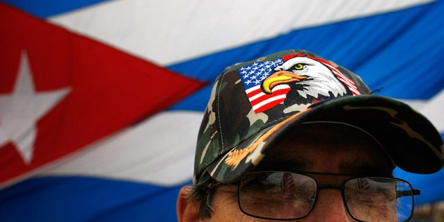 MIAMI - FEBRUARY 19: Ramiro Naval wears an American flag hat as he reacts to the news that Cuban President Fidel Castro announced he will not accept a new term in office in front of the Versailles restaurant in the Little Havana neighborhood February 19, 2008 in Miami, Florida. Castro has announced he is stepping down after 49 years in power, saying he is no longer healthy enough to hold office.  (Photo by Joe Raedle/Getty Images)