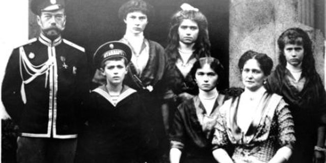 This undated photo shows Czar Nicholas II of Russia, far left, and his family. The remains of the czar and his wife were exhumed Wednesday, Sept. 23, 2015 in an effort to identify the remains of two of their children. (Reuters/File)