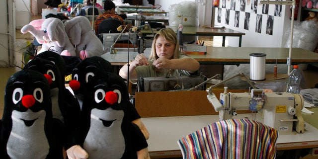 Nov. 9, 2011: A worker adjusts her sewing machine at the toy factory in Brno, Czech Republic. As Europe's economic crisis bites, toy manufacturers here are thriving. Profits are high, new markets are opening and Little Mole, a cartoon character created in 1956 and still going strong, is the unrivaled star.