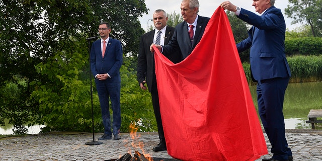 Pants on fire: The president of the Czech Republic stunned journalists at a press conference on Thursday where he set a giant pair of red underwear on fire