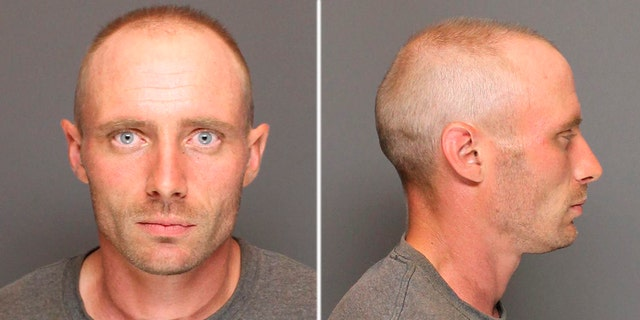 The driver of a vehicle was arrested Wednesday after a boulder it was carrying broke free and crashed into another car, killing two women, police said.