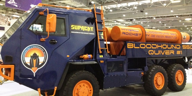 """Supacat's six-wheeled """"Quiver"""" support vehicle carries spare rockets for the supersonic speed team."""