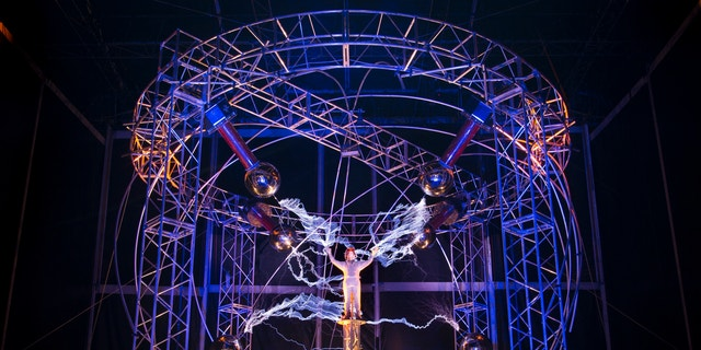 "Oct. 5, 2012: Magician David Blaine stands inside an apparatus surrounded by a million volts of electric currents streamed by tesla coils during his 72-hour ""Electrified: 1 Million Volts Always On"" stunt on Pier 54"