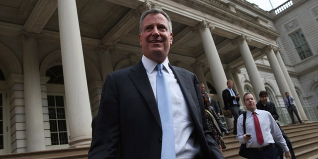 NEW YORK, NY - NOVEMBER 06:  New York City Mayor-elect Bill de Blasio leaves City Hall after meeting with outgoing Mayor Michael Bloomberg on November 6, 2013 in New York City. It was the first meeting between the two since de Blasio's election victory the day before.  (Photo by John Moore/Getty Images)