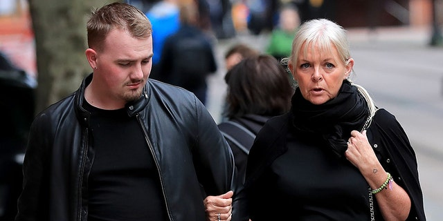 Seen with her son, Deborah Lowe (right) is on trial in the U.K. for one count of sexual activity with a child and five counts of sexual activity with a child by a person in a position of trust.