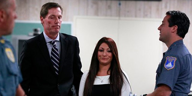 "July 3, 2012: ""Jersey Shore"" cast member Deena Cortese, center, walks with her attorney Michael Pappa, left, in court after a hearing in Seaside Heights, N.J."