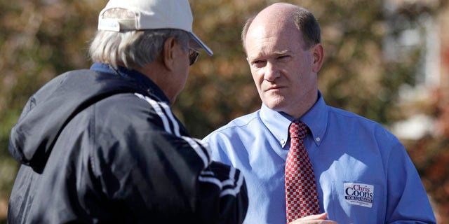 Nov. 2: Delaware Democratic Senate candidate Chris Coons, right, outside a polling station in Dover, Del.