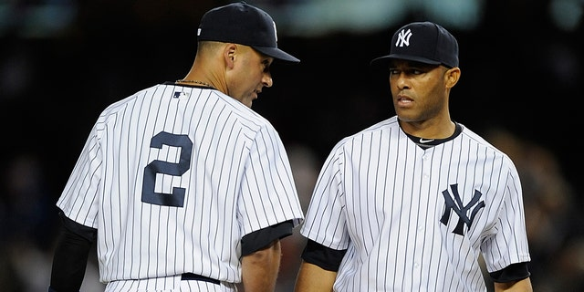 Rivera and Jeter during Game One against the Detroit Tigers on October 1, 2011 in New York City.
