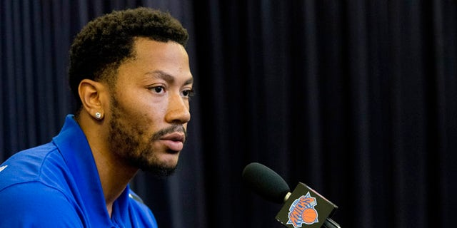 FILE - In this June 24, 2016, file photo, Derrick Rose speaks during a news conference for the New York Knicks to announce they acquired him from the Chicago Bulls at Madison Square Garden in New York. A Los Angeles federal judge ruled Tuesday, Sept. 20, that a woman accusing NBA star Rose of rape cannot remain anonymous at her upcoming civil trial. (AP Photo/Mary Altaffer, File)