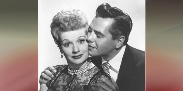 """Lucille Ball and Desi Arnaz, who played husband Ricky Ricardo on """"I Love Lucy,"""" during a photoshoot."""