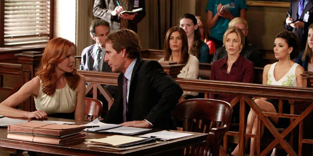 """In this publicity image released by ABC, Marcia Cross, left, and Scott Bakula are shown with, from right, Eva Longoria, Felicity Huffman and Teri Hatcher in a scene from the series finale of """"Desperate Housewives,"""" that was shown Sunday, May 13, 2012."""